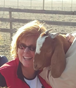 smiles with goats