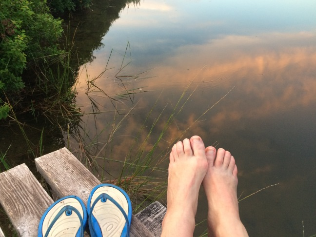 my feet with sunset