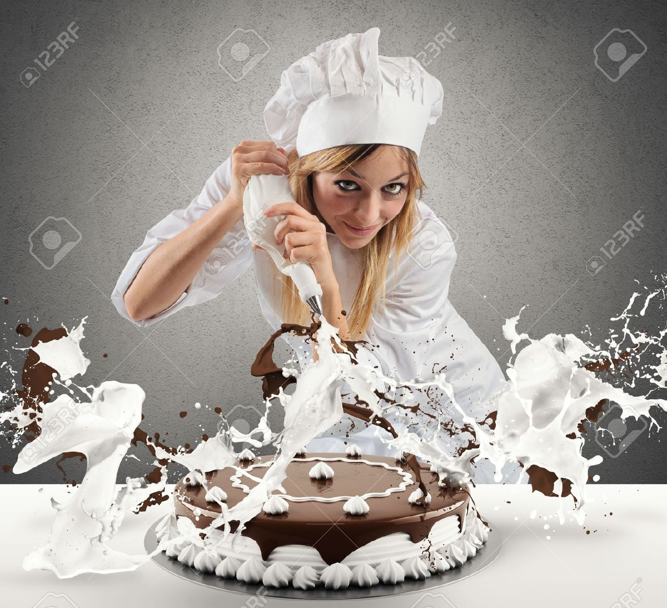 32493705-pastry-cook-prepares-a-cake-with-cream-and-chocolate-stock-photo